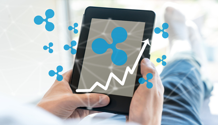 Ripple with man using a tablet computer Stock Photo
