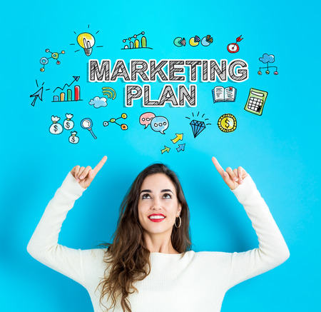 Marketing Plan with young woman reaching and looking upwards
