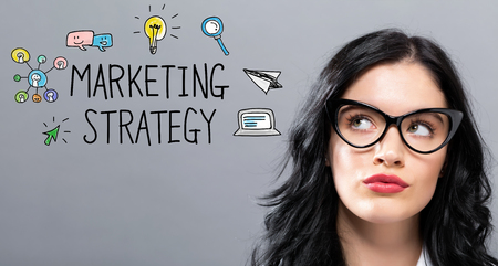 Marketing Strategy with young businesswoman in a thoughtful face Stock Photo