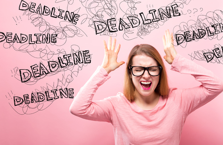 Deadline with young woman feeling stressed on a pink background Stockfoto