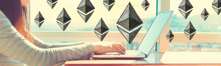 Ethereum with woman working on a laptop in brightly lit room