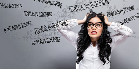 Deadline with young business woman feeling stressed