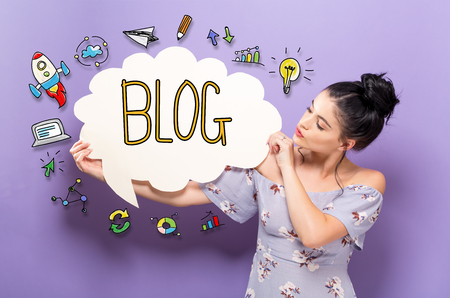 Blog with young woman holding a speech bubble Stock Photo