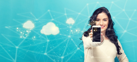 Cloud Computing with young woman holding out a smartphone in her hand