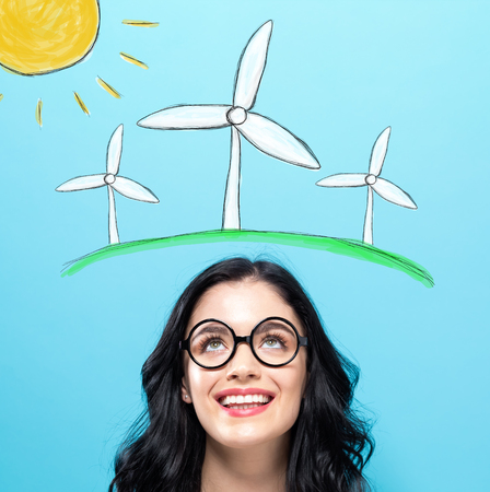 Windmills with happy young woman on a blue background