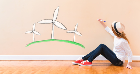 Windmills with young woman holding a pen on floor Stock Photo
