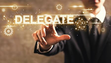 Delegate text with businessman on dark vintage background Banque d'images