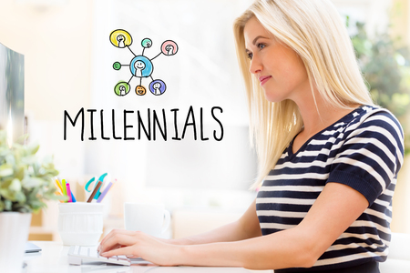 Millennials with happy young woman sitting at her desk in front of the computer