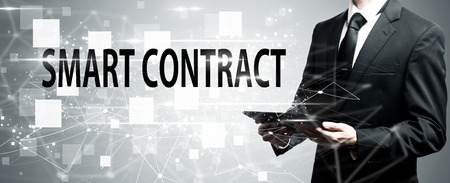 Smart Contract with man holding a tablet computer Stock Photo