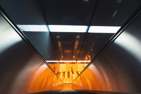 Motion blurred view of a moving escalator