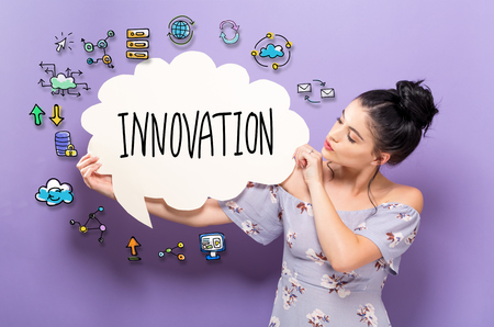 Innovation with young woman holding a speech bubble Archivio Fotografico - 96241213