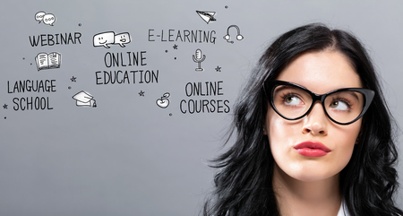 Online Education with young businesswoman in a thoughtful face 版權商用圖片
