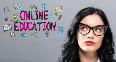 Online Education with young businesswoman in a thoughtful face Stok Fotoğraf