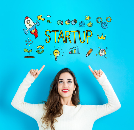 Startup with young woman reaching and looking upwards Stock Photo