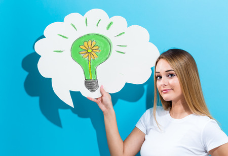 Eco Energy with young woman holding a speech bubble