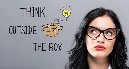 Think Outside The Box with young businesswoman in a thoughtful face Stock Photo - 96476459