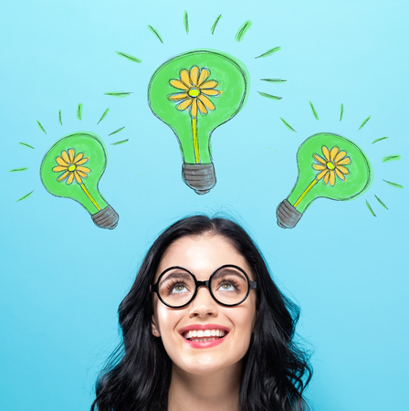 Eco Energy with happy young woman on a blue background