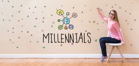 Millennials with young woman holding a pen in a chair Stock Photo