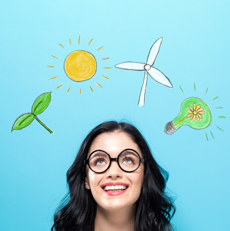 Ecology with happy young woman on a blue background