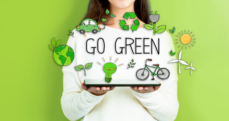 Go Green with woman holding a tablet computer