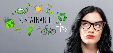 Sustainable with young businesswoman in a thoughtful face