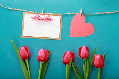 Valentines day theme with tulips and greeting card