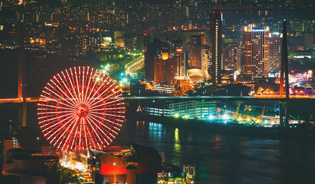 Aerial view of the Osaka Bay harbor area with the ferris wheel at night