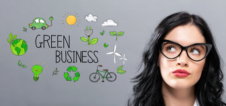 Green Business with young businesswoman in a thoughtful face Stock Photo