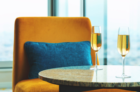 White wine on a table high above the city Standard-Bild