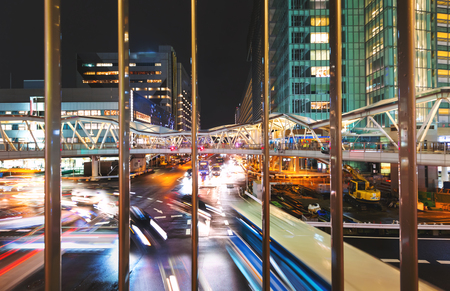 Traffic and people moving through Osaka, Japan at night