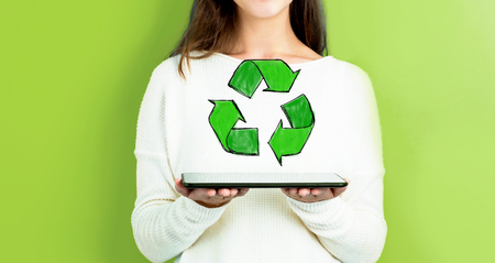 Recycle with woman holding a tablet computer Stok Fotoğraf