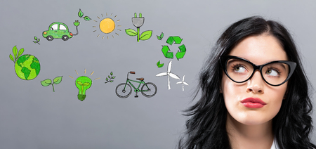 Ecology with young businesswoman in a thoughtful face Stock Photo