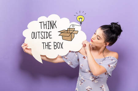 Think Outside The Box with young woman holding a speech bubble