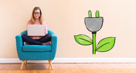 Eco Plug with young woman using her laptop in a chair