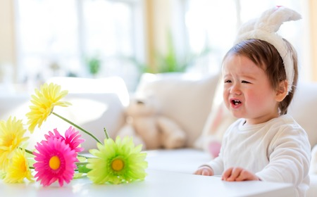 Crying toddler boy preparing for Easter Sunday