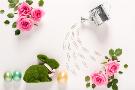 Easter theme with roses, watering can and bunny Stock Photo