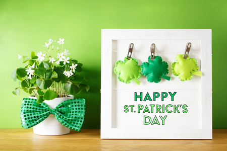 Saint Patricks Day message board with clover cushions