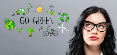 Go Green with young businesswoman in a thoughtful face Banco de Imagens