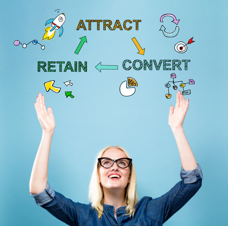 Attract Convert Retain with young woman reaching and looking upwards Stock Photo