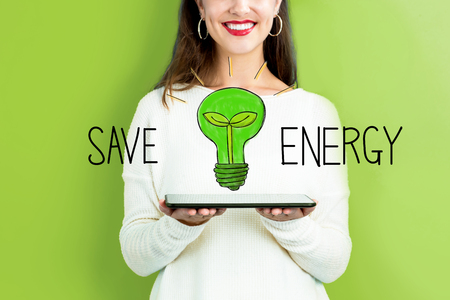 Save Energy with woman holding a tablet computer