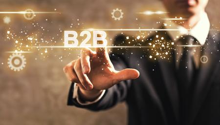B2B text with businessman on dark vintage background 스톡 콘텐츠