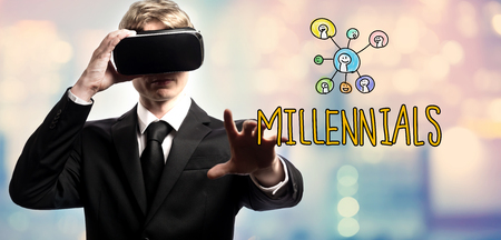 Millennials text with businessman using a virtual reality headset Stock Photo