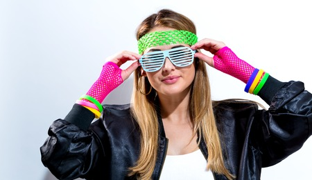 Woman in 1980s fashion on a white background Standard-Bild