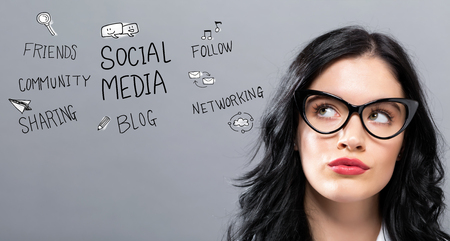 Social Media with young businesswoman in a thoughtful face