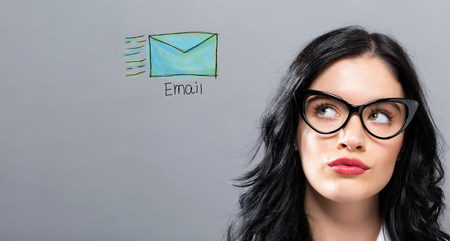 Email with young businesswoman in a thoughtful face Stock Photo