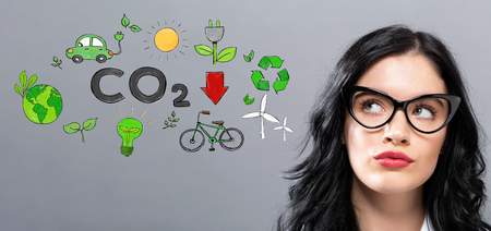 Reduce CO2 with young businesswoman in a thoughtful face Banco de Imagens