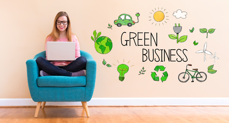 Green Business with young woman using her laptop in a chair Stok Fotoğraf - 98031192