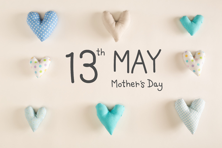 Mothers Day message with blue heart cushions on a white paper background Stock Photo - 98320842
