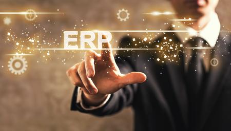 ERP text with businessman on dark vintage background