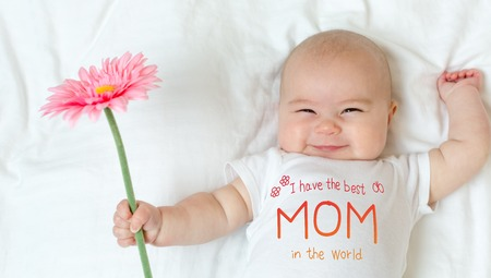 Mothers Day message with baby girl holding a flower